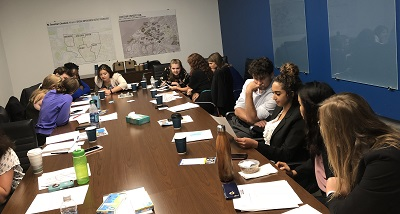 A group of interns sits at conference table at Downtown Cleveland Alliance