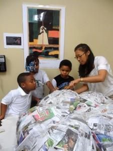 Kop working with Rainey students