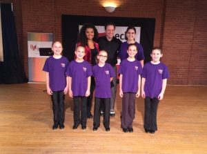 Tap dancers pose in group photo