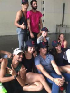 Malpaso dancers model their new Cleveland Indians baseball caps