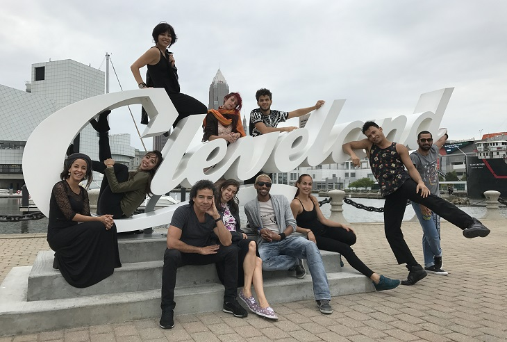 Malpaso Dance Company dancers pose in front of Cleveland script sign