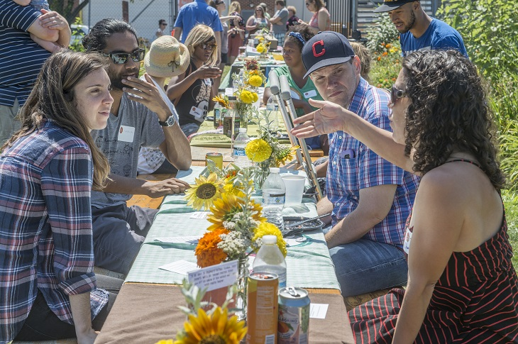 Ohio City Inc. and The Global Table hosted a community potluck at the Ohio City Farm to discuss how we can create welcoming neighborhoods for all residents. (Photo credit: Rob Muller)