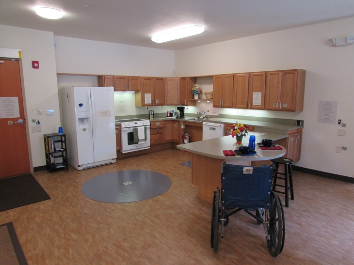 Image of MAHO model unit shows a kitchen space and wheelchair