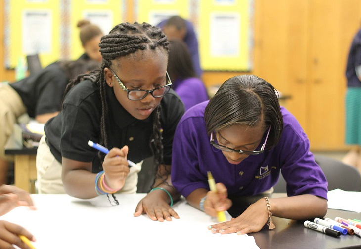 Two students at a Breakthrough School work on a project together