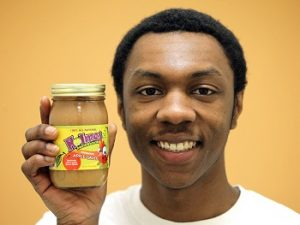 Holmes Mouthwatering Applesauce founder Ethan Holmes poses with a jar of his applesauce