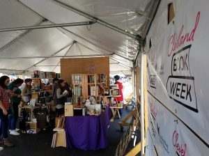 book shelves and tent at Cleveland Flea