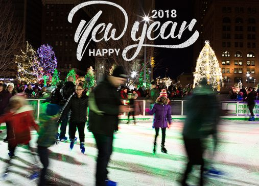 People skating on Cleveland Foundation Skating Rink with Happy New Year graphic