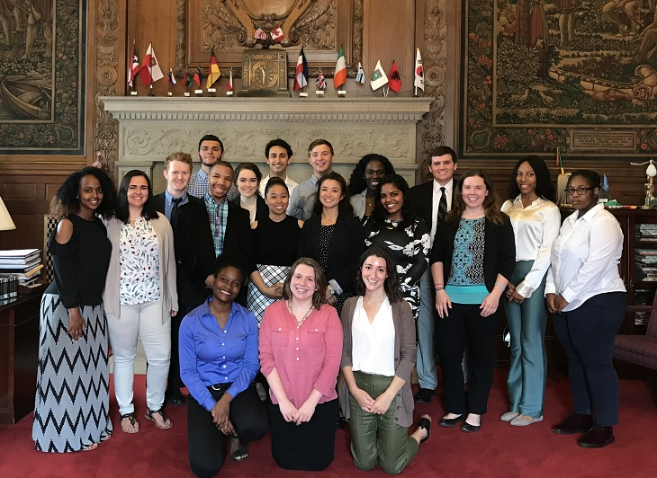 2017 Cleveland Foundation Summer Interns stand in front of fireplace in Mayor's office