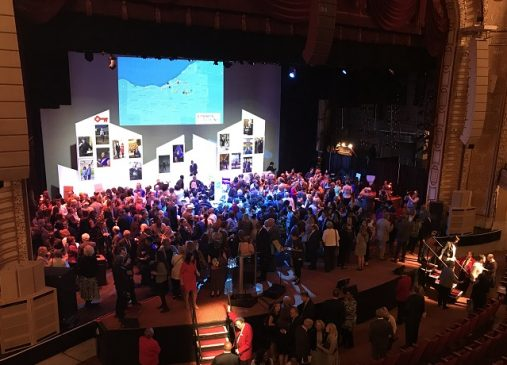 crowd pictured onstage at 2018 annual meeting community reception