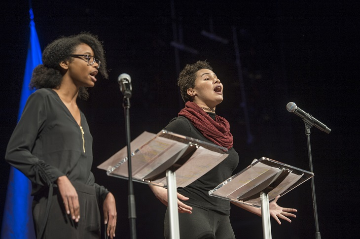 Young poets pictured on stage during performance