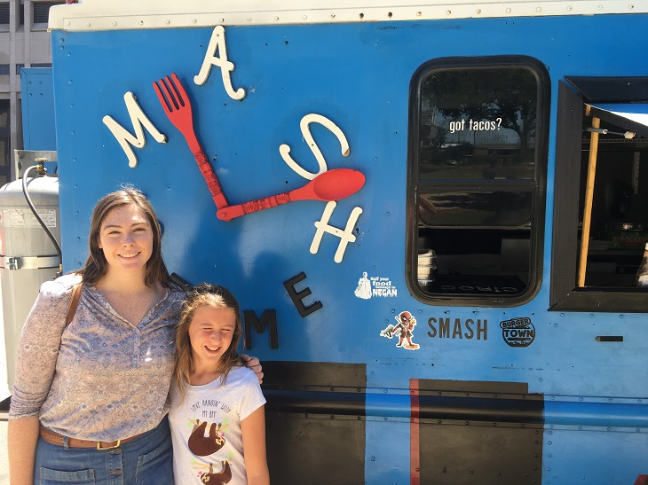 Image of Monica and a girl in front of a food truck