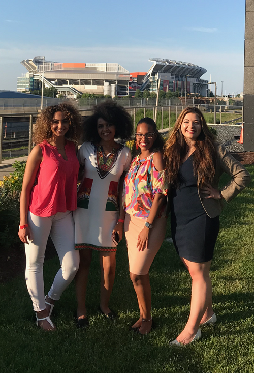 Simone and three other women stand in front of Browns Stadium