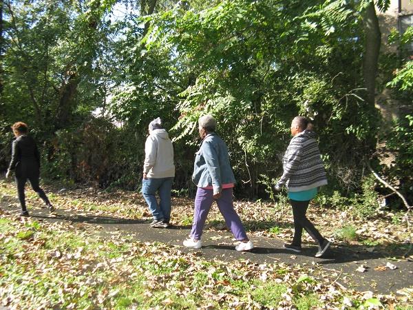 People walking outside on a trail